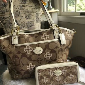 White and tan coach purse with flowers